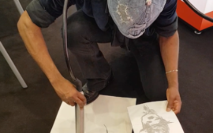 Artist creates Charlie Chaplin portrait with industrial printer